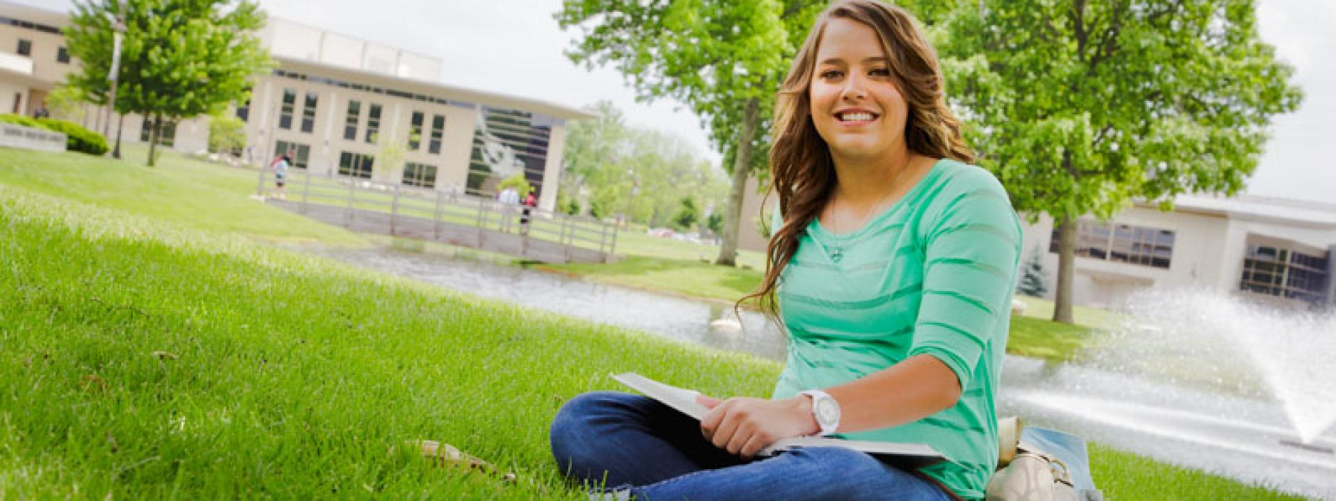 COTC student sitting in grass