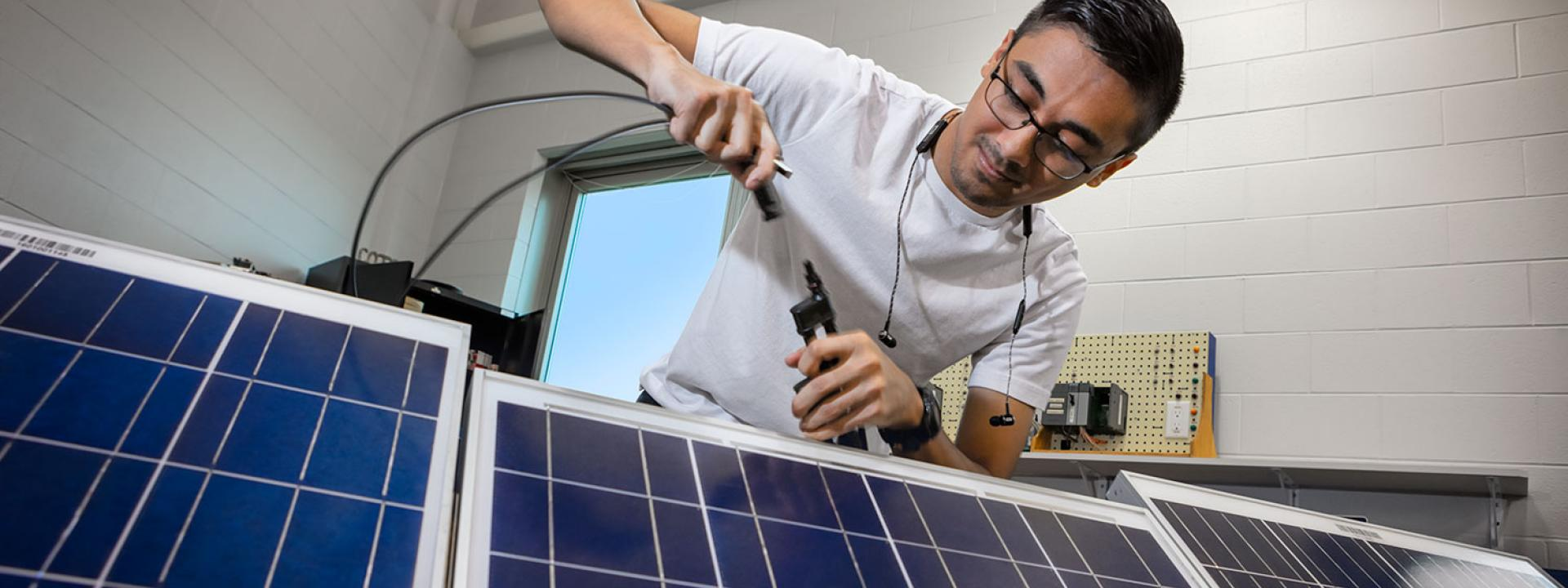 Engineering Student working on solar panels