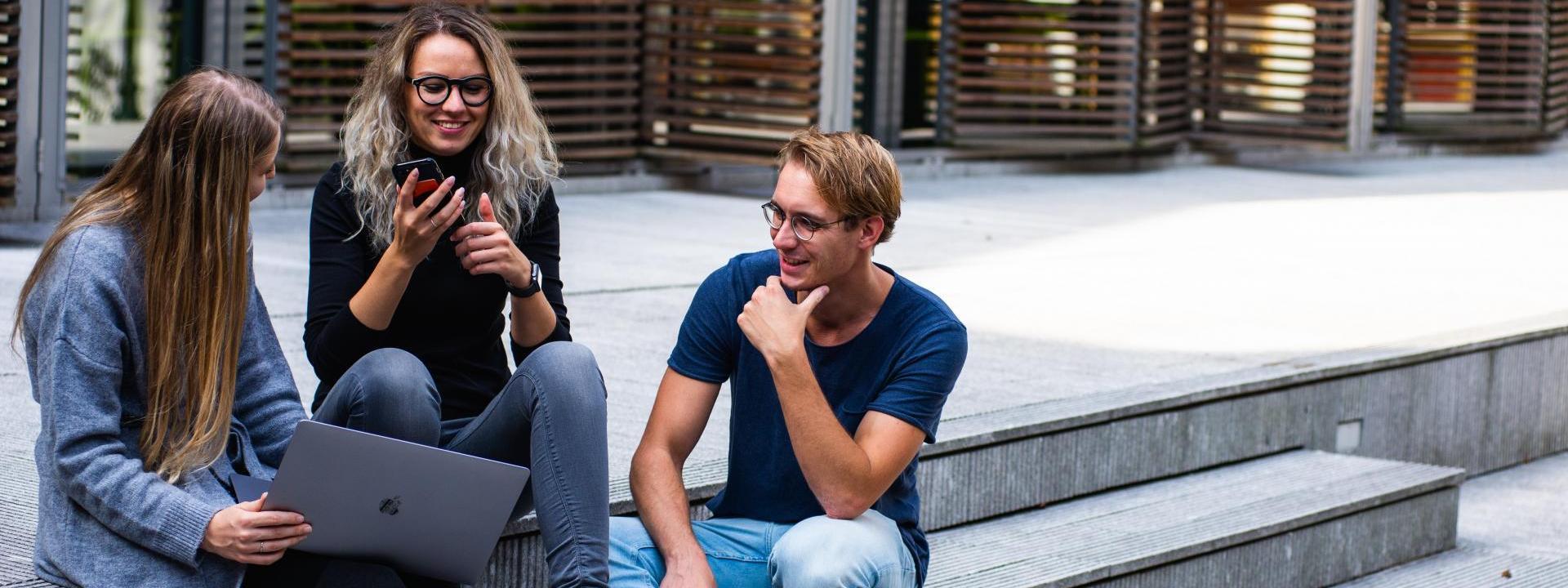 3 students talking