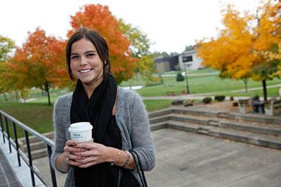 COTC Student holding coffee