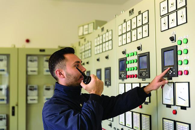 A student at an electrical panel