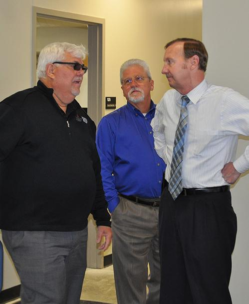 Three men talking at the open house
