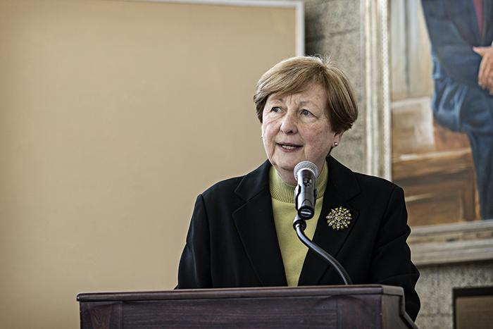 A woman speaking at the groundbreaking ceremony