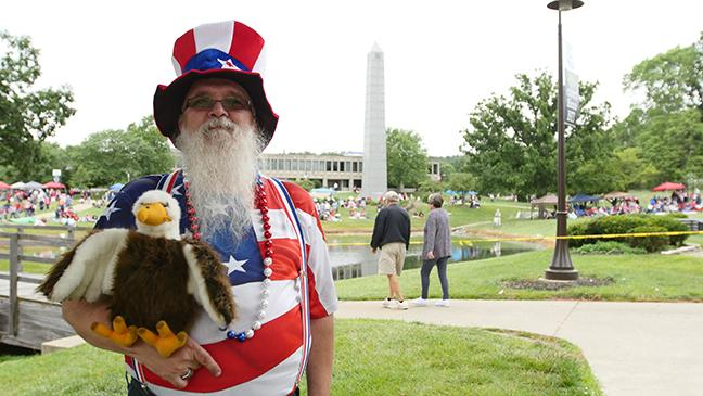 Patriotic man holding eagle stuffed animal