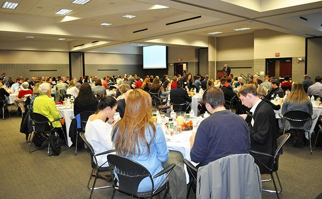 Another image of people eating at the scholarship breakfast