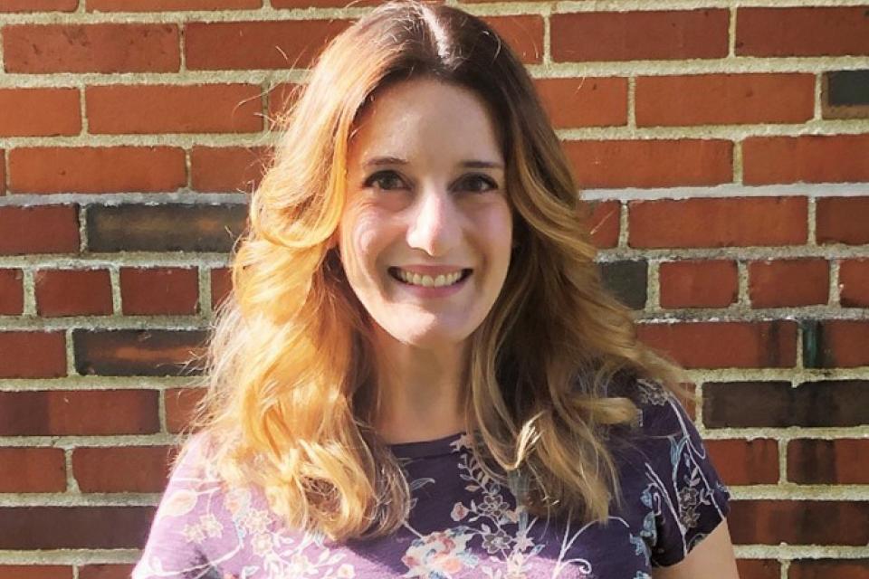 Denise Turner smiling for a portrait.